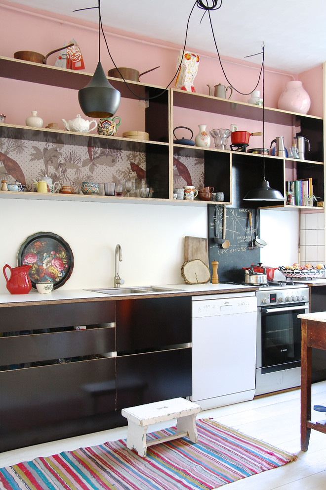 Inspiration for a scandinavian kitchen remodel in Amsterdam with open cabinets, black cabinets, laminate countertops, white appliances and white backsplash