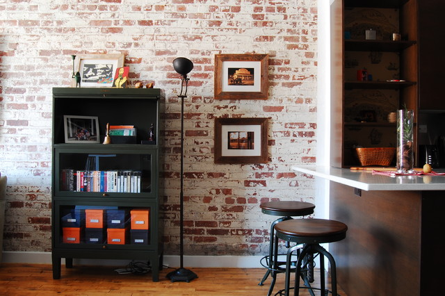 Example of an urban kitchen design in New York with dark wood cabinets