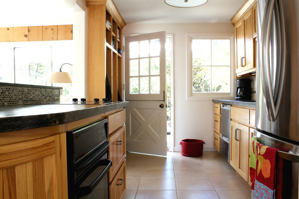 Enclosed kitchen - traditional galley enclosed kitchen idea in San Francisco with recessed-panel cabinets, medium tone wood cabinets, granite countertops and stainless steel appliances