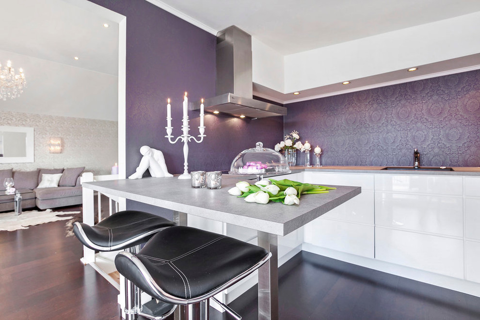 Trendy kitchen photo in Other with flat-panel cabinets and white cabinets