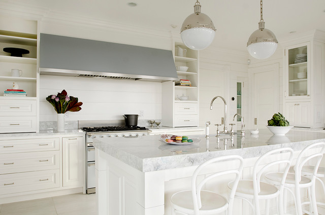 Inspiration for a large timeless eat-in kitchen remodel in Boston with raised-panel cabinets, white cabinets and an island