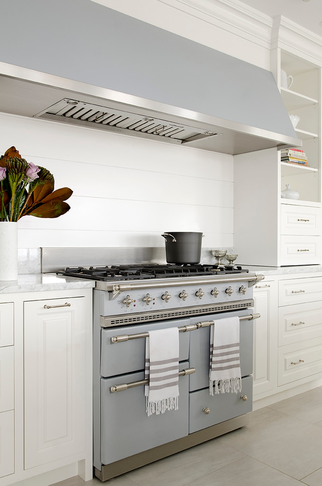 Beach style kitchen photo in New York with colored appliances