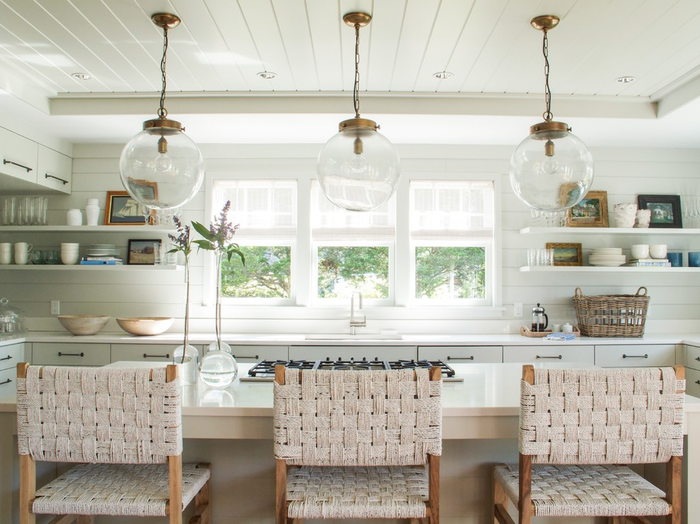 Kitchen - coastal u-shaped kitchen idea in Charleston with an undermount sink, open cabinets, white cabinets and an island