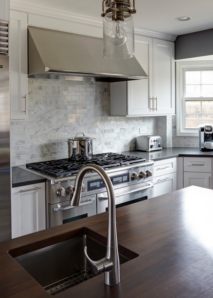Eat-in kitchen - large transitional dark wood floor eat-in kitchen idea in Chicago with a single-bowl sink, shaker cabinets, white cabinets, quartz countertops, white backsplash, stone tile backsplash, stainless steel appliances and two islands