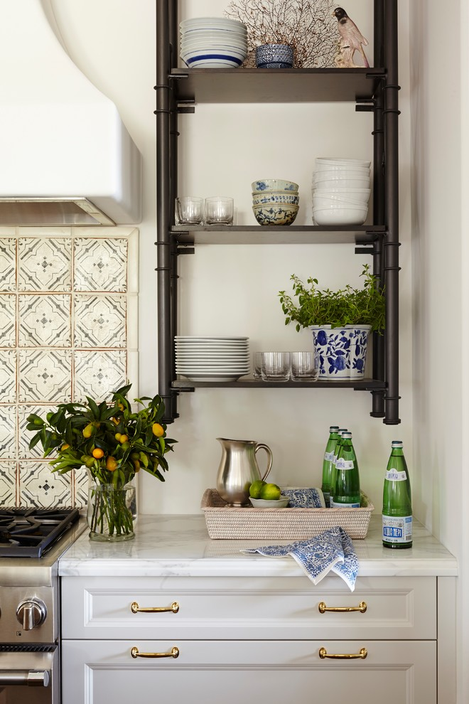 Eat-in kitchen - large tropical single-wall dark wood floor eat-in kitchen idea in Miami with an undermount sink, shaker cabinets, white cabinets, marble countertops, white backsplash, cement tile backsplash, paneled appliances and an island