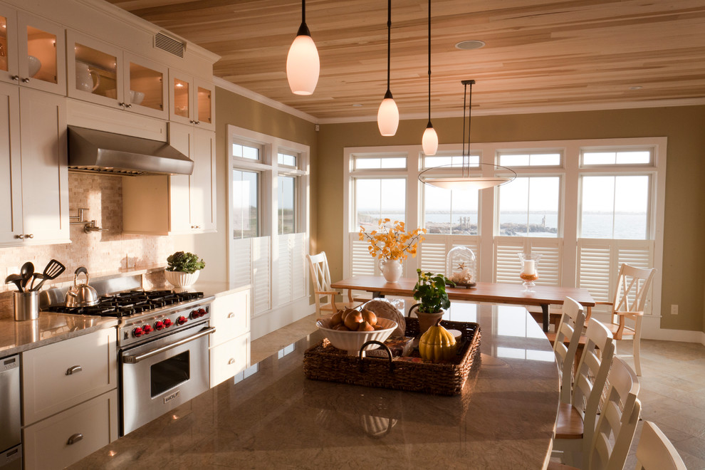 Eat-in kitchen - large contemporary l-shaped beige floor and ceramic tile eat-in kitchen idea in Salt Lake City with an undermount sink, white cabinets, granite countertops, stone tile backsplash, stainless steel appliances, an island, beige countertops, shaker cabinets and beige backsplash