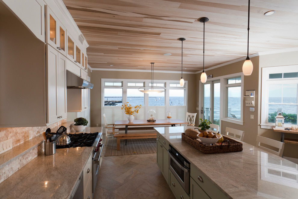 Example of a large trendy l-shaped beige floor and ceramic tile eat-in kitchen design in Salt Lake City with an undermount sink, white cabinets, granite countertops, beige backsplash, stone tile backsplash, stainless steel appliances, an island, beige countertops and shaker cabinets