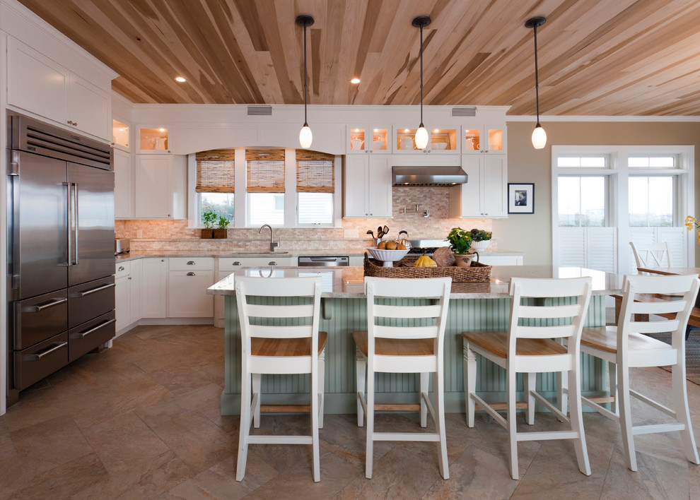 Large trendy l-shaped beige floor and ceramic tile eat-in kitchen photo in Salt Lake City with an undermount sink, white cabinets, granite countertops, beige backsplash, stone tile backsplash, stainless steel appliances, an island, beige countertops and shaker cabinets