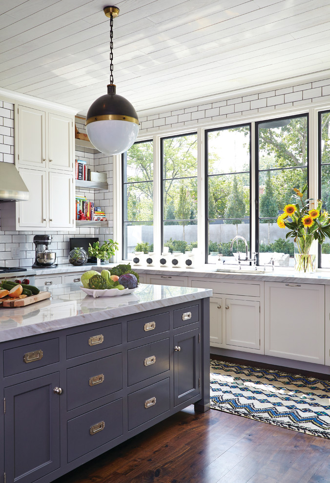 Kitchen - transitional dark wood floor kitchen idea in Nashville with shaker cabinets, white cabinets, white backsplash, subway tile backsplash, an island and white countertops
