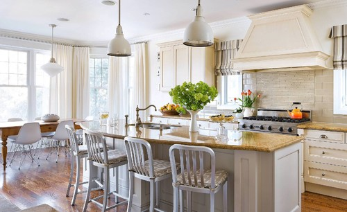 Modern traditional kitchen featuring four stools with a geometric pattern on the seat cushion