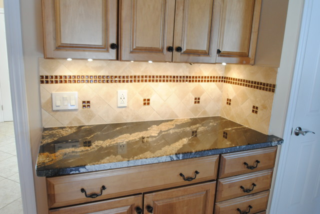 natural stone and tantrum glass backsplash
