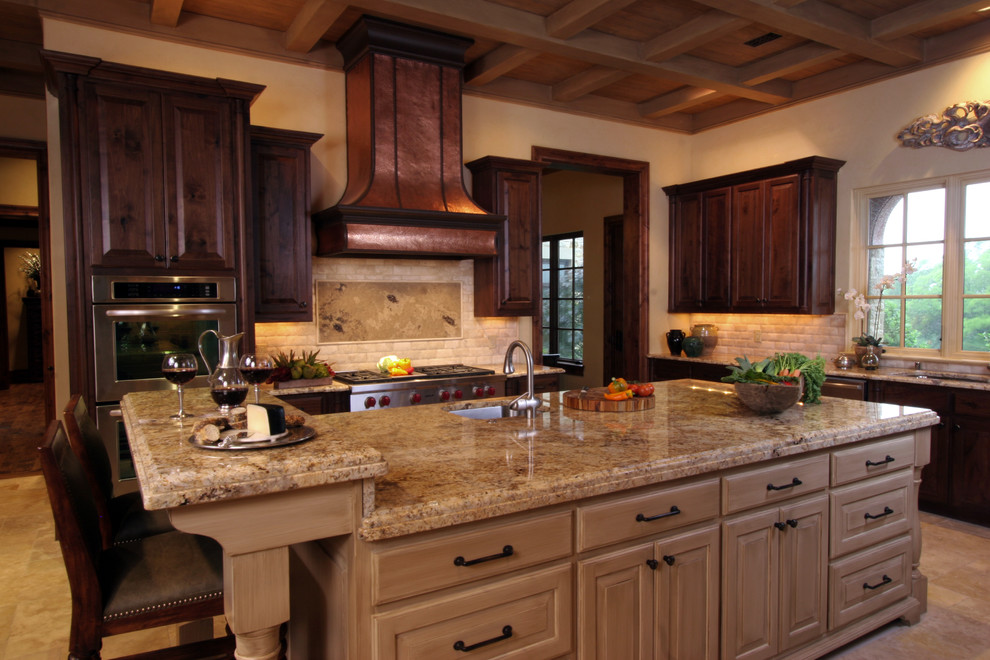 Example of a tuscan kitchen design in Dallas