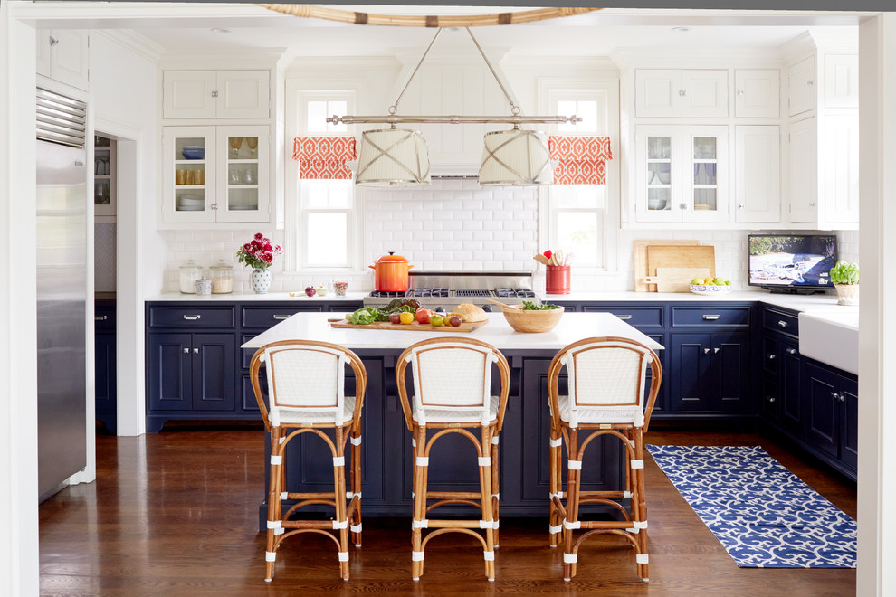 Inspiration for a large coastal dark wood floor eat-in kitchen remodel in Los Angeles with a farmhouse sink, beaded inset cabinets, blue cabinets, marble countertops, white backsplash, stainless steel appliances, an island and subway tile backsplash