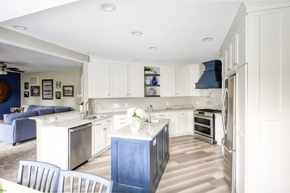 Open concept kitchen - mid-sized transitional u-shaped laminate floor and gray floor open concept kitchen idea in DC Metro with an undermount sink, shaker cabinets, white cabinets, quartzite countertops, stainless steel appliances, an island and white countertops