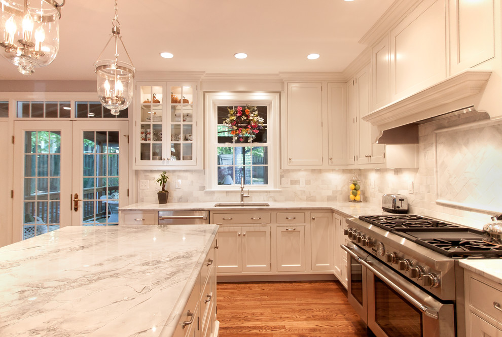 Kitchen - large contemporary medium tone wood floor kitchen idea in DC Metro with beaded inset cabinets, white cabinets, granite countertops and an island