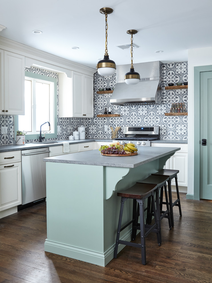 Eat-in kitchen - mid-sized farmhouse l-shaped dark wood floor and brown floor eat-in kitchen idea in New York with raised-panel cabinets, white cabinets, quartz countertops, multicolored backsplash, cement tile backsplash, stainless steel appliances, an island, gray countertops and an undermount sink