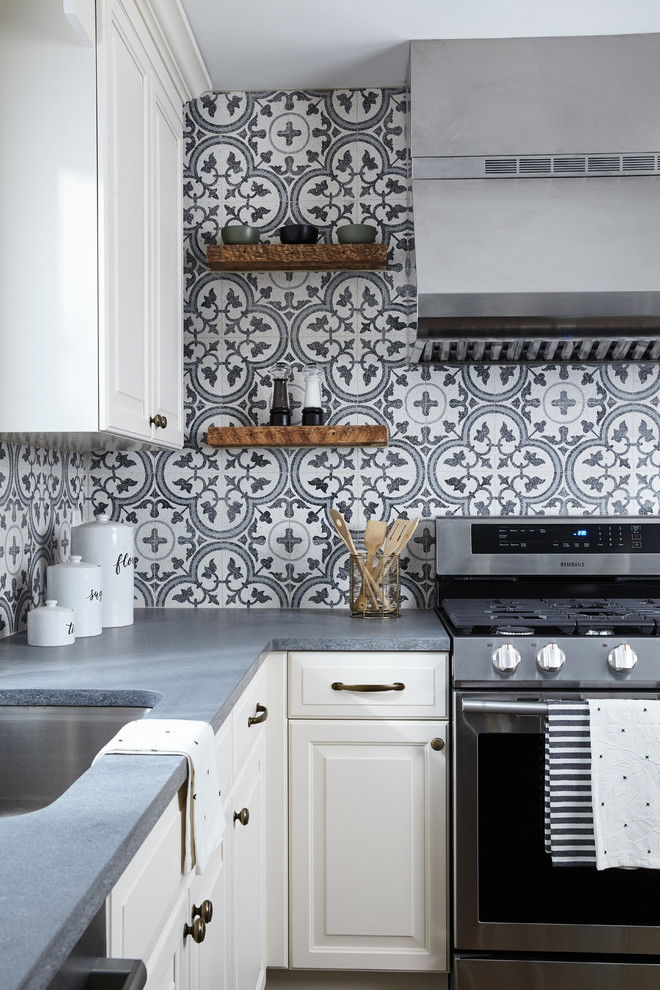 Example of a mid-sized farmhouse l-shaped eat-in kitchen design in New York with raised-panel cabinets, white cabinets, quartz countertops, multicolored backsplash, cement tile backsplash, stainless steel appliances, an island and gray countertops