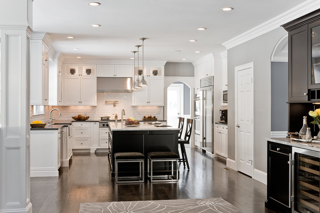 Elegant l-shaped kitchen photo in Boston with stainless steel appliances, a  farmhouse sink