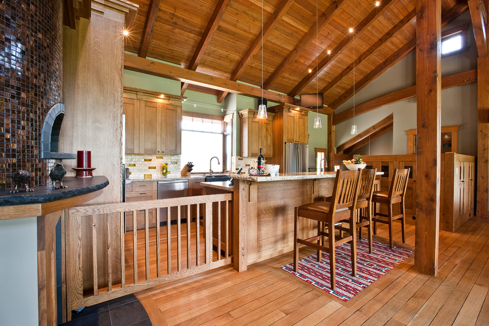 Arts and crafts kitchen photo in Calgary with a farmhouse sink, medium tone wood cabinets, granite countertops, multicolored backsplash and stainless steel appliances