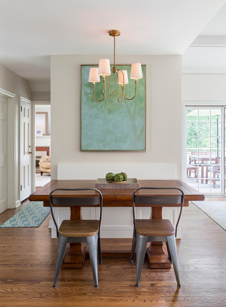 Mid-sized transitional medium tone wood floor eat-in kitchen photo in Minneapolis with a farmhouse sink, shaker cabinets, white cabinets, quartzite countertops, white backsplash, subway tile backsplash and an island