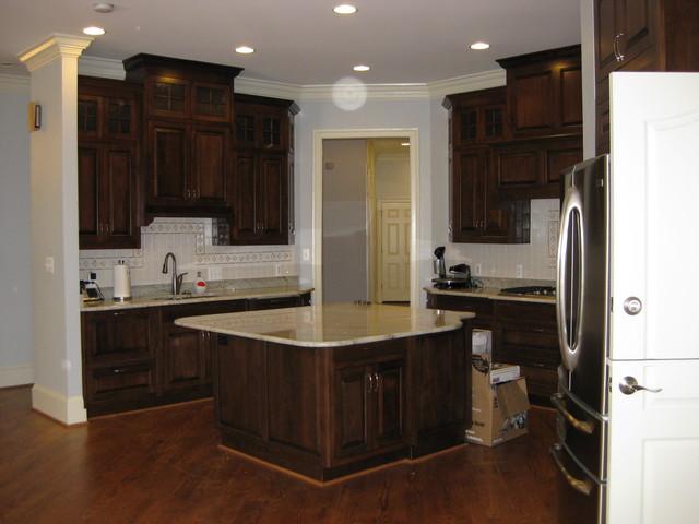 new build kitchen Cosmic White Granite, dark brown cabinets Falls