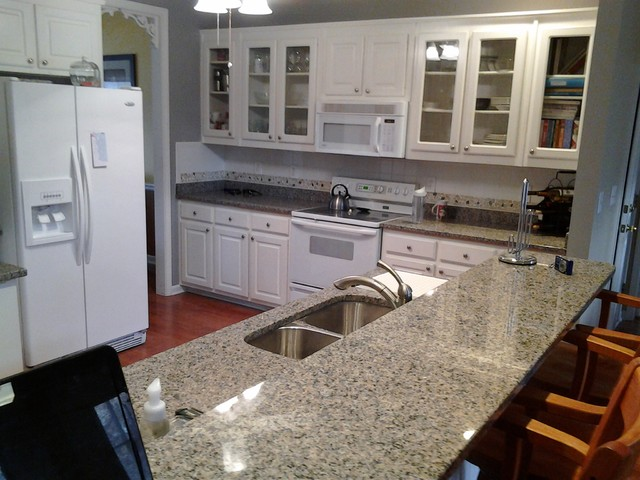 white kitchen cabinets with new caledonia granite new caledonia traditional kitchen atlanta by e amp d 29035