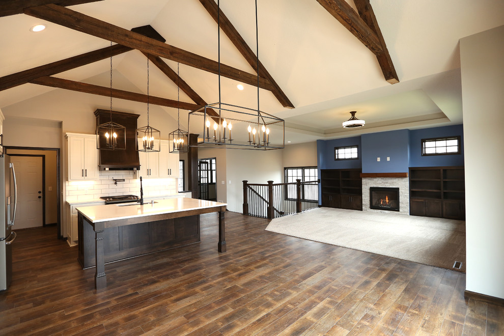 Inspiration for a large craftsman vinyl floor and brown floor open concept kitchen remodel in Minneapolis with an undermount sink, shaker cabinets, white cabinets, quartz countertops, white backsplash, subway tile backsplash, stainless steel appliances, an island and white countertops