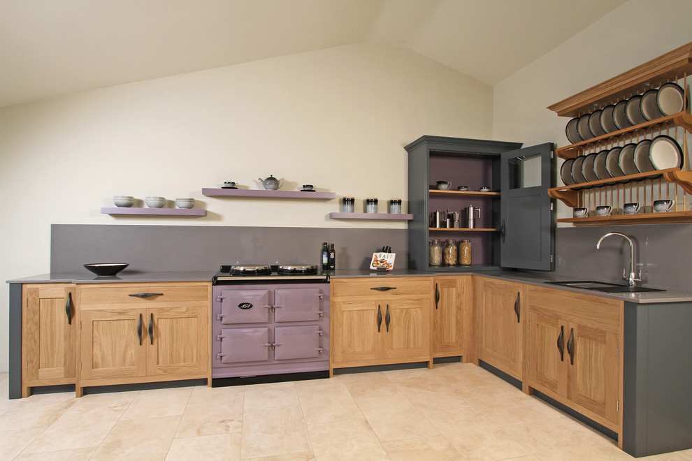 Trendy kitchen photo in Hampshire with shaker cabinets and colored appliances