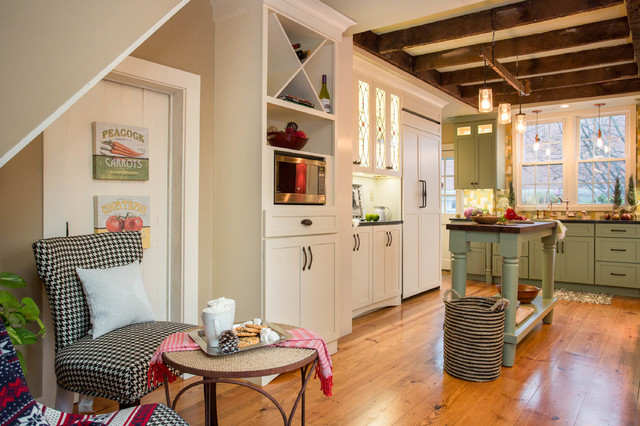 Eat-in kitchen - large cottage u-shaped medium tone wood floor eat-in kitchen idea in Boston with an undermount sink, shaker cabinets, green cabinets, granite countertops, multicolored backsplash, mosaic tile backsplash, paneled appliances and an island