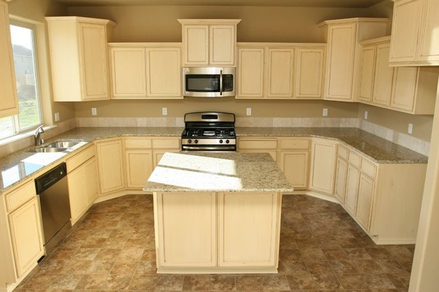 Distressed white Cabinets traditional kitchen New house