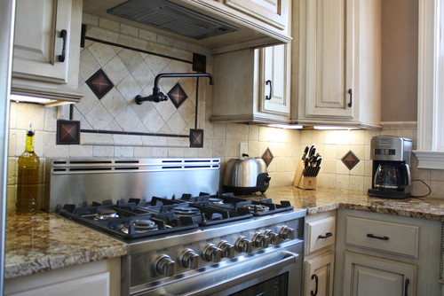 what is the name of the tile backsplash and bronze accent tile
