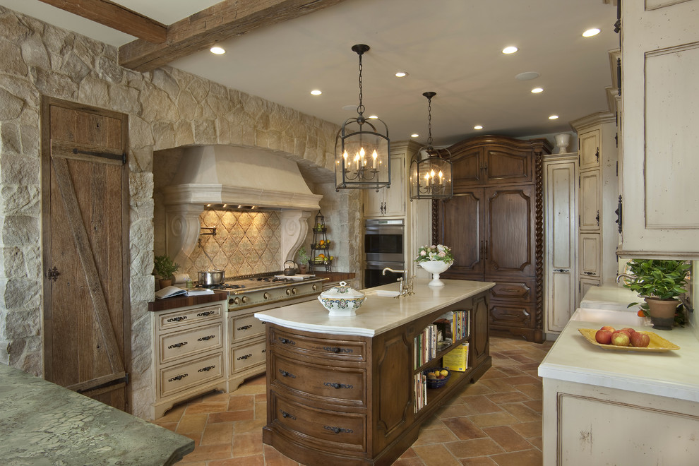 Large tuscan u-shaped marble floor and brown floor enclosed kitchen photo in San Diego with paneled appliances, beige cabinets, an undermount sink, recessed-panel cabinets, marble countertops, beige backsplash, stone tile backsplash and an island