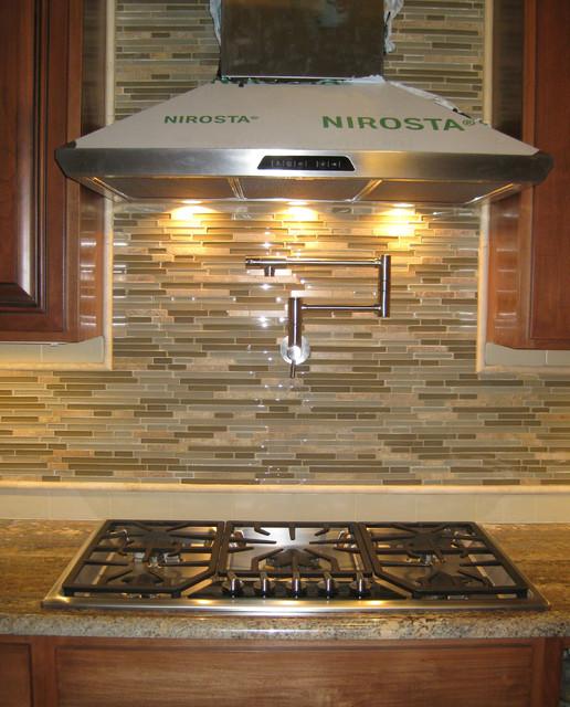 new mosaic tile backsplash with pot filler faucet and venthood
