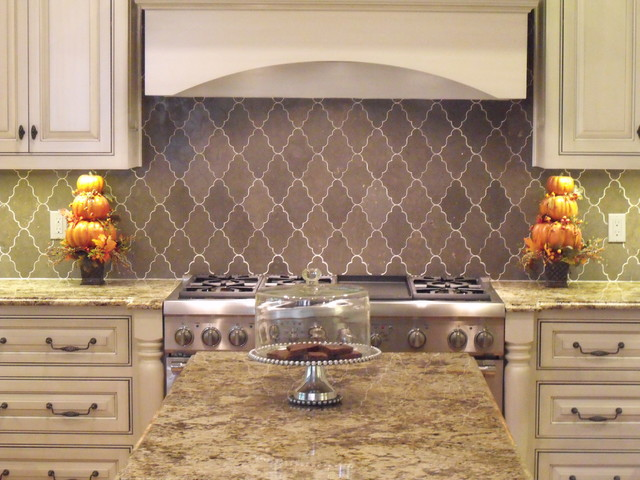 New ravenna djinn limestone backsplash traditional kitchen jacksonville by eberling design - Traditional kitchen tile backsplash ideas ...