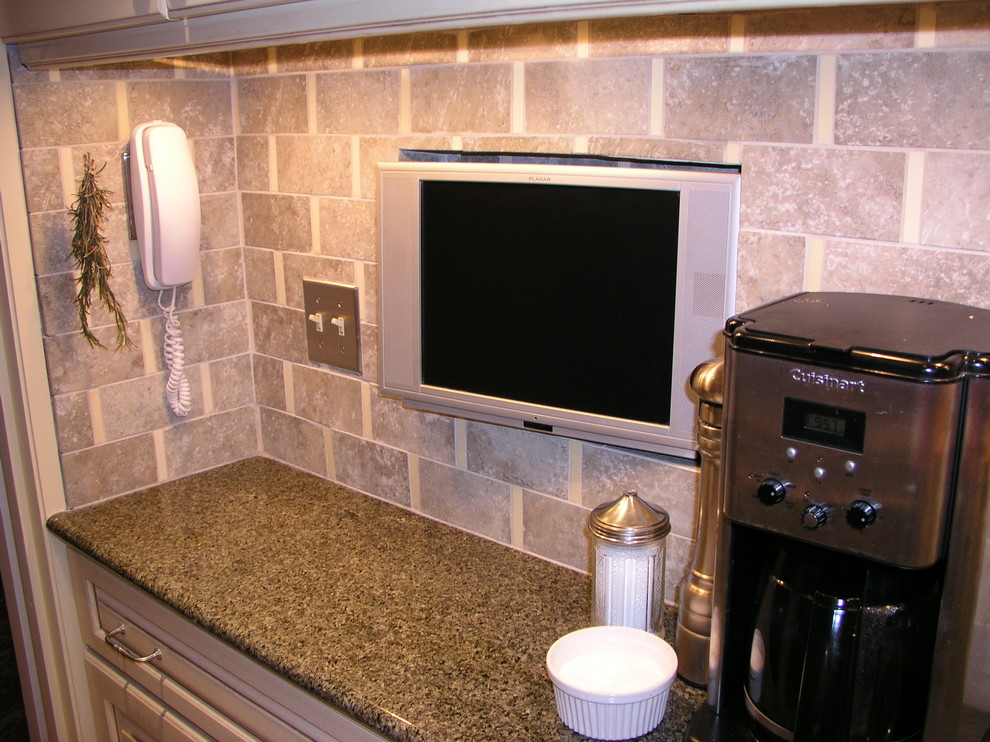 Small transitional galley ceramic tile enclosed kitchen photo in New York with raised-panel cabinets, granite countertops, ceramic backsplash, stainless steel appliances and no island