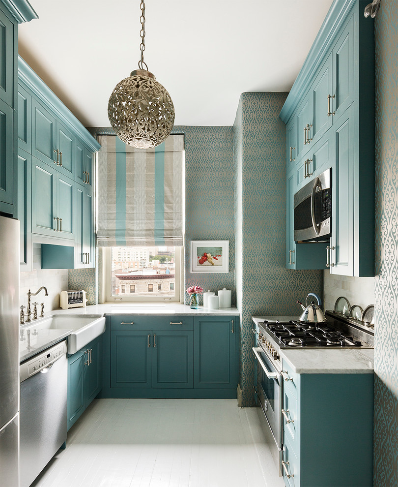 Enclosed kitchen - small transitional u-shaped enclosed kitchen idea in New York with a farmhouse sink, shaker cabinets, blue cabinets, marble countertops, stainless steel appliances and no island