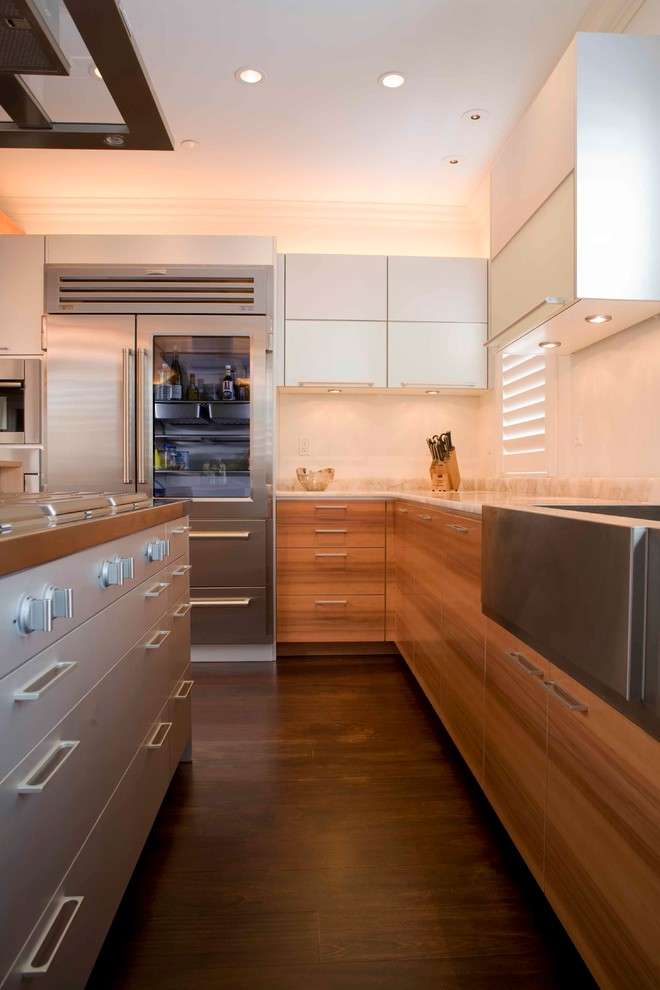 Example of a minimalist kitchen design in Boston with stainless steel appliances