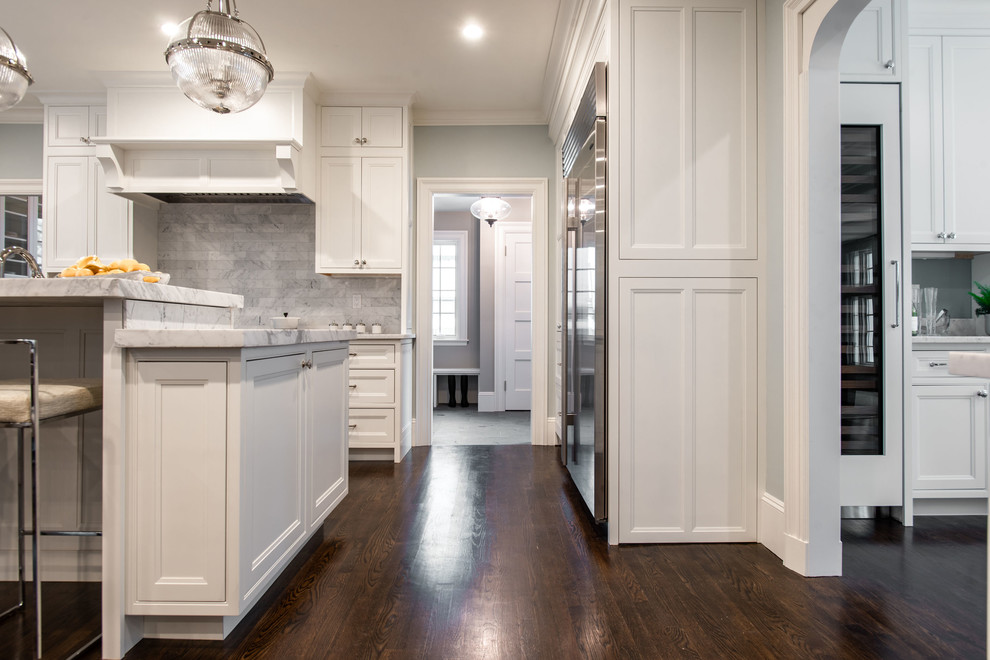 Eat-in kitchen - huge traditional l-shaped dark wood floor and brown floor eat-in kitchen idea in Boston with an undermount sink, beaded inset cabinets, white cabinets, marble countertops, gray backsplash, marble backsplash, stainless steel appliances, an island and white countertops