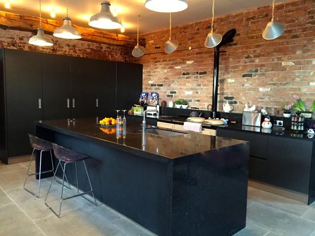 Rustic Black Kitchen next 125 lava black matt glass and matt lacquer with silestone
