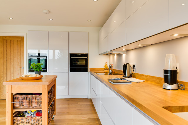 Modern White Kitchen With Wooden Worktops And Stainless Steel Appliances Stock Photo 9027496