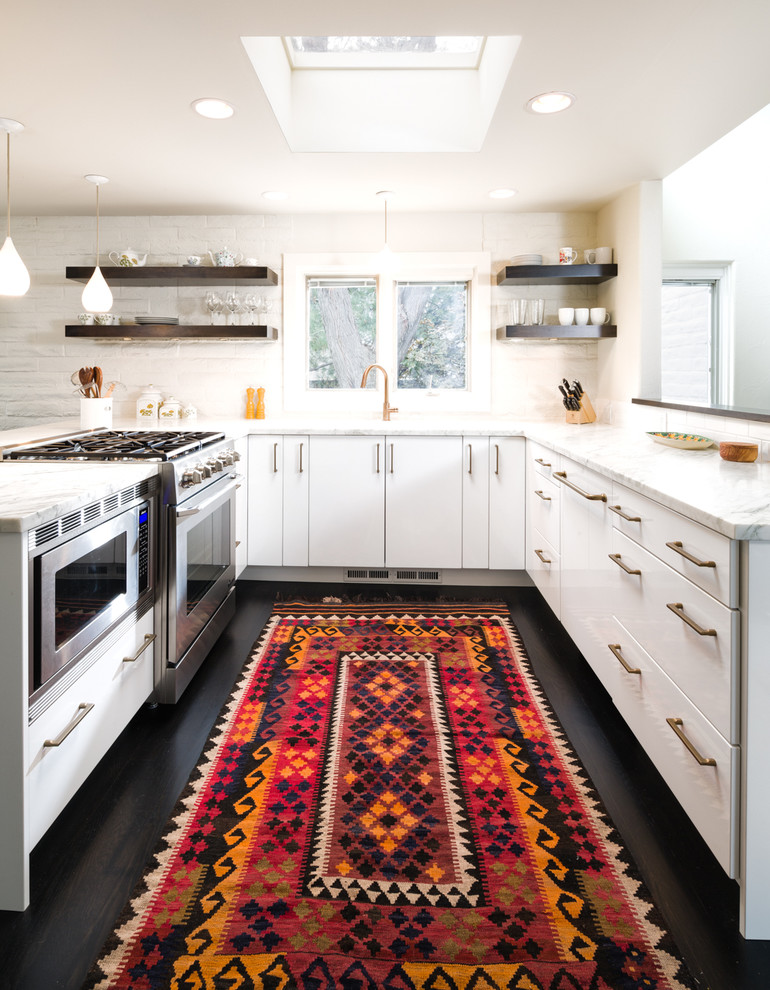Example of a trendy u-shaped kitchen design in Denver with flat-panel cabinets, white cabinets and white backsplash