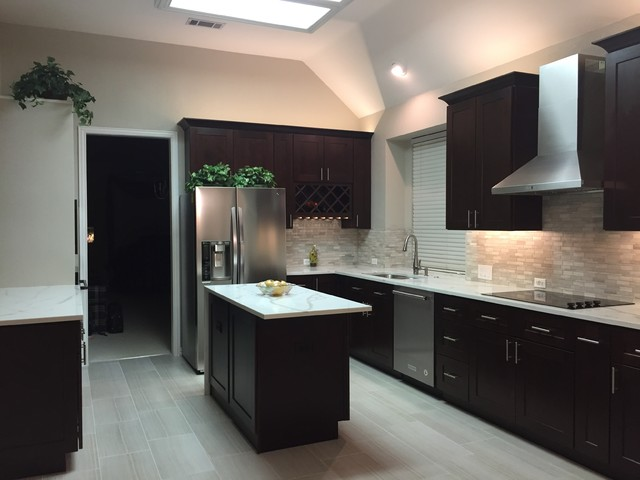 Eat-in kitchen - large transitional galley porcelain floor eat-in kitchen idea in Dallas with an undermount sink, shaker cabinets, dark wood cabinets, quartzite countertops, gray backsplash, stone tile backsplash, stainless steel appliances and two islands