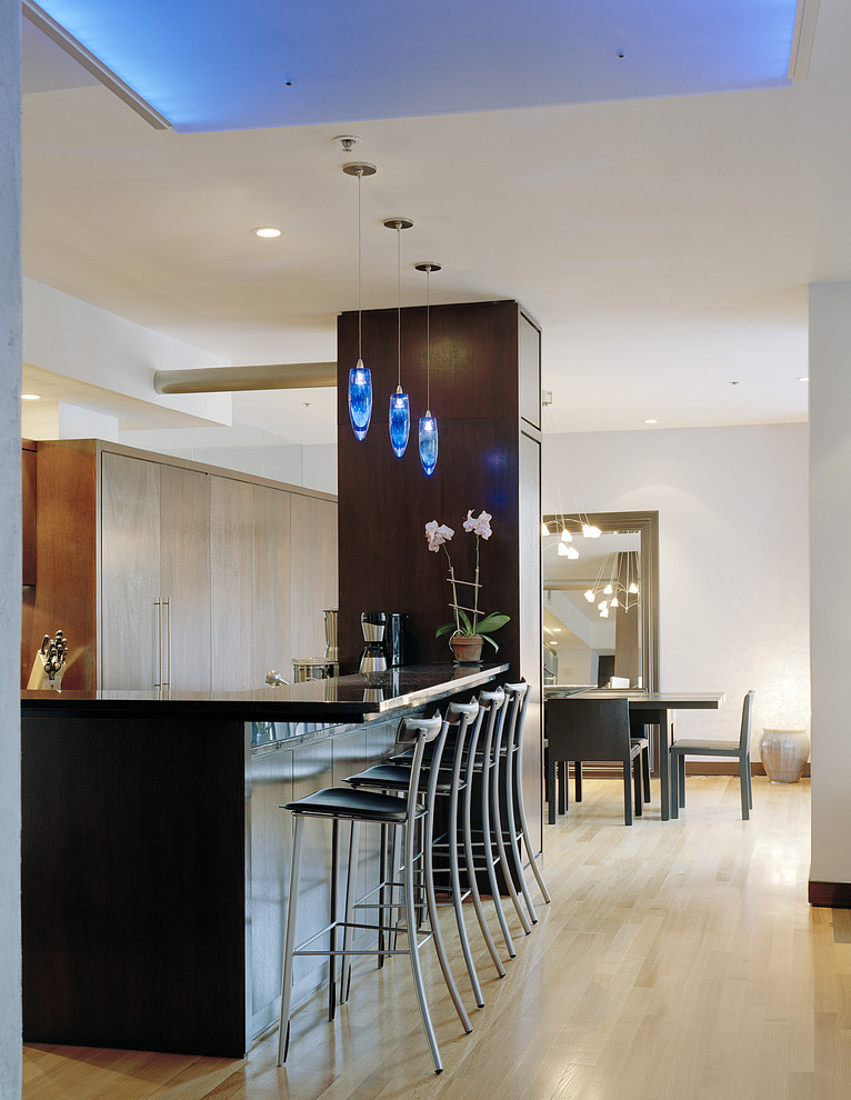 Inspiration for a contemporary eat-in kitchen remodel in Boston with granite countertops, flat-panel cabinets and medium tone wood cabinets