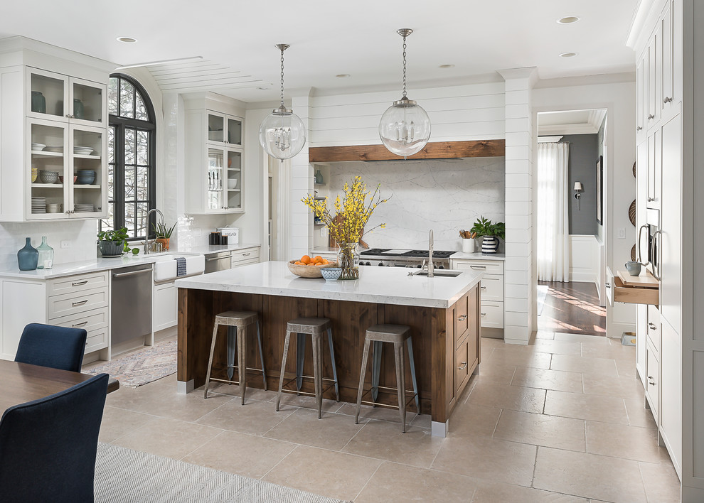 Eat-in kitchen - large transitional u-shaped beige floor eat-in kitchen idea in Chicago with a farmhouse sink, shaker cabinets, white cabinets, white backsplash, stainless steel appliances and an island