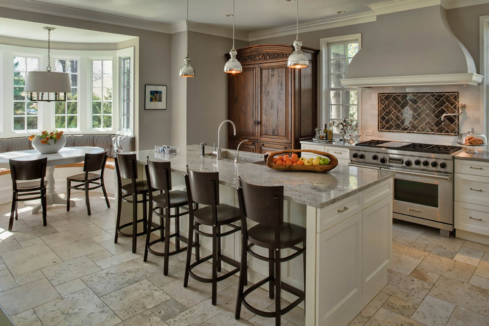 Eat-in kitchen - traditional eat-in kitchen idea in Chicago with shaker cabinets, white cabinets, brown backsplash and stainless steel appliances
