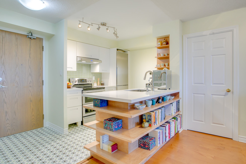Inspiration for a small contemporary galley cement tile floor and multicolored floor eat-in kitchen remodel in Toronto with an undermount sink, flat-panel cabinets, white cabinets, quartzite countertops, green backsplash, glass tile backsplash, stainless steel appliances, a peninsula and white countertops