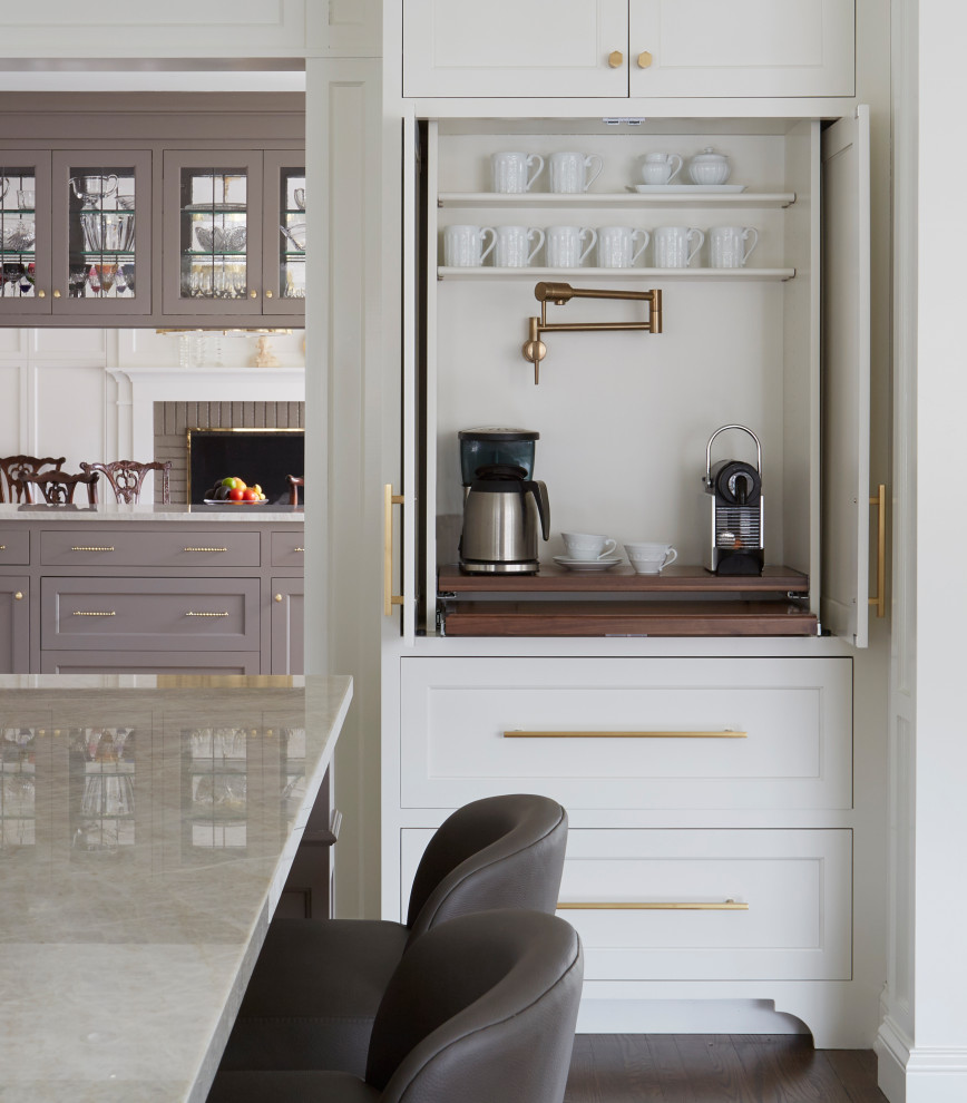 Example of a transitional u-shaped medium tone wood floor and brown floor open concept kitchen design in Chicago with an undermount sink, recessed-panel cabinets, quartzite countertops, beige backsplash, ceramic backsplash, paneled appliances, an island and beige countertops