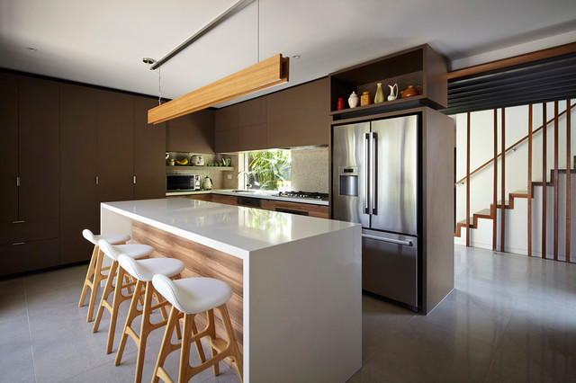 Inspiration for a large contemporary l-shaped kitchen remodel in Melbourne with flat-panel cabinets, brown cabinets, stainless steel appliances and an island