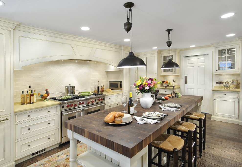 Inspiration for a victorian kitchen remodel in Chicago with stainless steel appliances and wood countertops