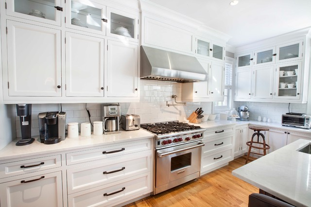kitchen photo in new york with an undermount sink cabinets
